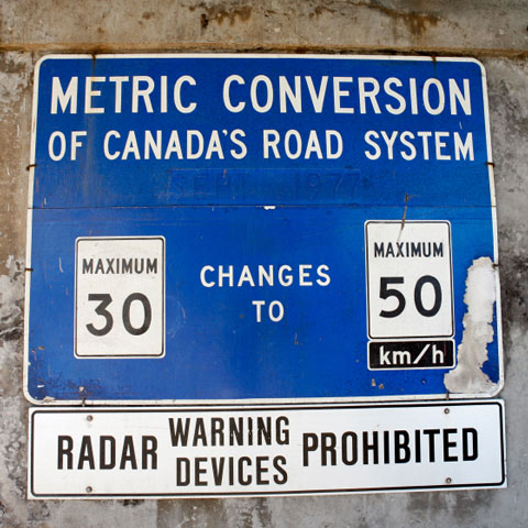 sign announcing metric conversion of Canada's road system, September, 1977